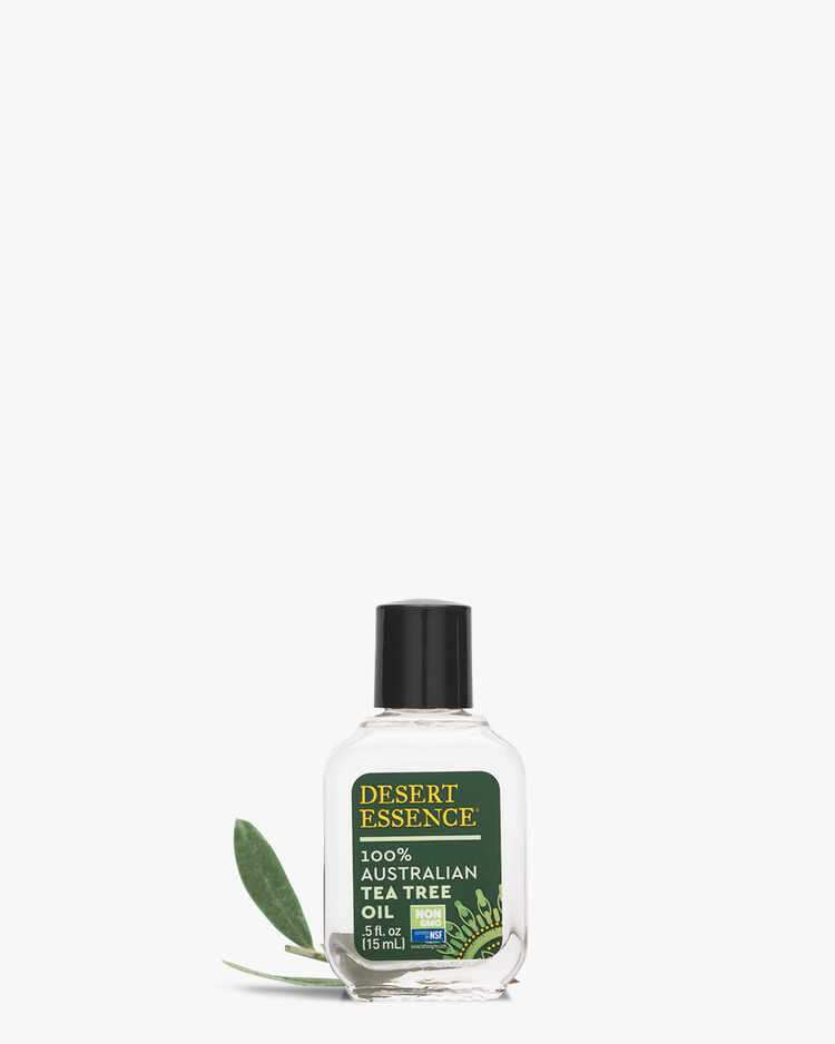 100% Australian Tea Tree Oil Placed In Front of Tea Tree Leaves
